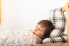 Sleeping boy. Boy sleeping in a bed on pillow under blanket with flowers Royalty Free Stock Images