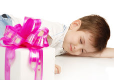The sleeping boy with a gift royalty free stock images