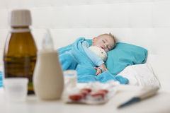 Sleeping boy with his toy Royalty Free Stock Photos