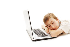 Sleeping boy with a laptop Royalty Free Stock Images