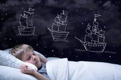 Sleeping boy. Sleeping little boy having a dream about big adventure stock image