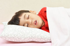 Sleeping boy. With pillow and blanket Stock Image