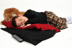 Sleeping Boy on Pillows Stock Photo