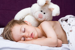Sleeping boy and rabbit toy Royalty Free Stock Photos
