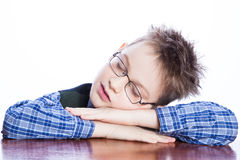Sleeping boy on the table Stock Photo