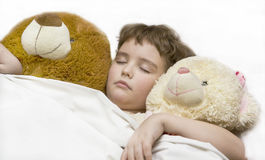 Sleeping boy with two bears Royalty Free Stock Photo