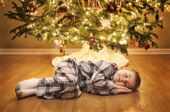 Sleeping boy waiting for Santa Stock Photo