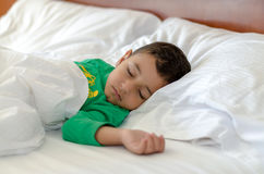 A Sleeping boy. A 4 years old boy taking a nap mid day Royalty Free Stock Photos