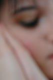 Sleeping brunette Stock Images