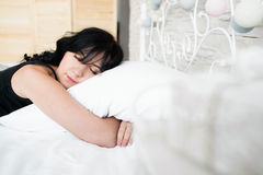 Sleeping brunette woman hugs pillow copyspace Royalty Free Stock Photography