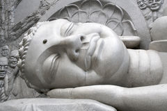 Sleeping Buddha. Photography of the head of the sleeping Buddha sculpture Stock Image
