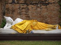 Sleeping Buddha. A sleep buddha in the gardens surrounding a Thai wat Royalty Free Stock Image