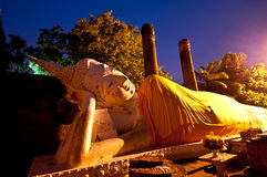 Sleeping Buddha. Stock Photo: Sleeping Buddha and Twilight time Stock Photo
