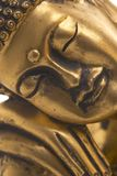 Sleeping Buddha. Close-up of a Buddha statue with face and hands Stock Photography