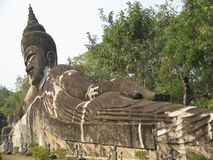 Sleeping Buddha. A big sleeping buddha statue in Laos. Sleeping buddha represent buddha go into nivana Stock Images