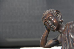 Sleeping Buddha Bronze. Traditional Bronze Sleeping Buddha Statue Stock Photo