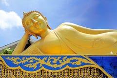 Sleeping Buddha. Great Buddha sleeps in front of Wat Lampang Klang temple, Lampang Thailand Royalty Free Stock Photo