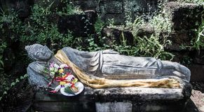 Sleeping buddha. With vertical garden background Stock Images