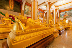Sleeping Buddha statue and other inside hall of famous Wat Chalong. PHUKET, THAILAND - FEB 6: Sleeping Buddha statue and other inside hall of famous Wat Chalong Stock Images