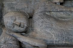 Sleeping buddha statue in Sri Lanka. Sleeping buddha statue near the city of Polonnaruwa in Sri Lanka royalty free stock photography