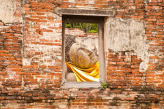 Sleeping Buddha Statue  in Window Royalty Free Stock Image