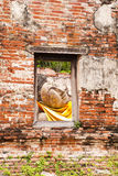 Sleeping Buddha Statue in Window. At Wat Putthaisawan Temple Ayutthaya , Thailand royalty free stock photography