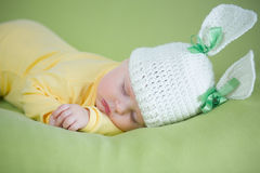 Sleeping bunny baby in funny hat Royalty Free Stock Images