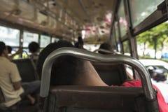 Sleeping bus passengers. Scene of unidentified sleeping man in public omnibus of bangkok in Bangkok, Thailand Royalty Free Stock Image
