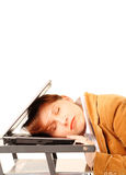 Sleeping business woman. Young business woman sleeping on her laptop, isolated over white background Stock Photography