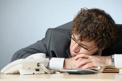 Sleeping businessman. Horizontal image of sleeping businessman Royalty Free Stock Photography