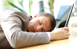 sleeping businessman in an office Royalty Free Stock Images