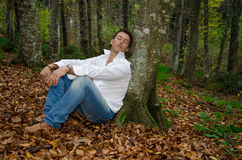 Sleeping businessman in the woods Royalty Free Stock Images