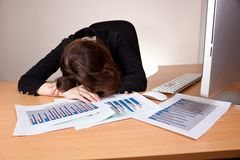Sleeping businesswoman with financial report Royalty Free Stock Image