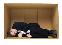 Sleeping in a cardboard box Stock Photography