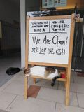 Sleeping cats and signboard. At a shop entrance, nap, napping, cute, funny, stray, community, feline, animal, furry, friends, mammal, domestic, tame, sleepy stock photos