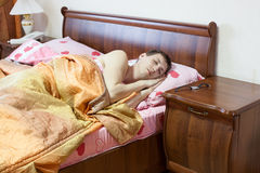 Sleeping Caucasian man in the bed Royalty Free Stock Photos