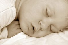 The sleeping child. Face of boy stock image