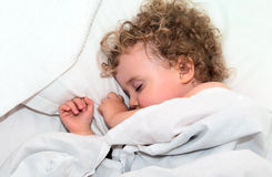 Sleeping child. Child sleeping in his bed Royalty Free Stock Photo