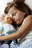 Sleeping child. Sleeping young girl in the bed Royalty Free Stock Image