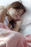 Sleeping child. Sleeping young girl in the bed Royalty Free Stock Photos