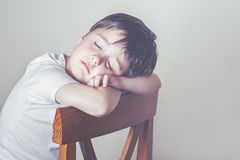 Sleeping child. Child asleep in a chair Royalty Free Stock Images