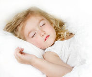 Sleeping child in bed Royalty Free Stock Photography