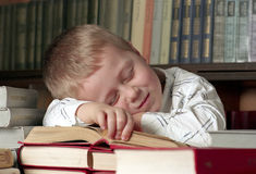 Sleeping  child on books Royalty Free Stock Images