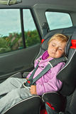 Sleeping child in car seat Royalty Free Stock Image
