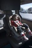 Sleeping Child in carseat. Child Sleeping in Carseat in sunshine Royalty Free Stock Photos