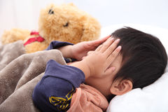 Sleeping child hands off covering face Stock Photography