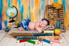 A sleeping child on a pile of books. Little schoolgirl. Royalty Free Stock Photo