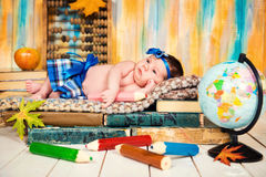 A sleeping child on a pile of books. Little schoolgirl. Royalty Free Stock Image