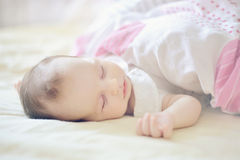 Sleeping child portrait in pastel tones. Royalty Free Stock Photo