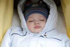 Sleeping child in stroller Stock Image
